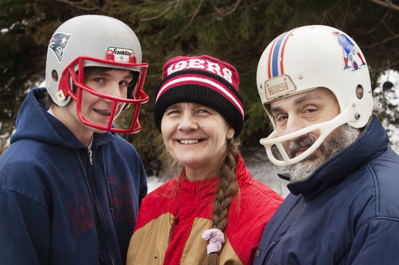 The Clement family, Bert, 17, Cathy and Bill, of South Portland, wear their New England Patriots headgear on Saturday, in anticipation of Sunday's AFC Championship game against the Baltimore Ravens.