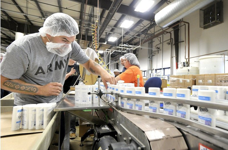 A Tom's of Maine employee works on the deodorant line at the company's plant in Sanford.