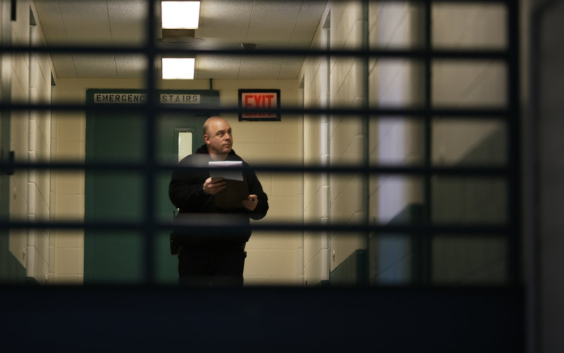 Corrections Officer Gary Osgood performs noontime checks at the Maine Correctional Center in Windham on Friday.