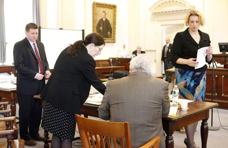 Deputy District Attorney Justina McGettigan, center, and Daniel Lilley, defense attorney for Mark Strong Sr., talk during a hearing recess. At left is Assistant District Attorney Patrick Gordon and at right is Tina Nadeau, co-counsel for Strong. Nadeau and Lilley argued on Tuesday for charges against Mark Strong Sr. to be dropped. They said prosecutors had failed to release key evidence before the trial that could have been used in Strong's defense.
