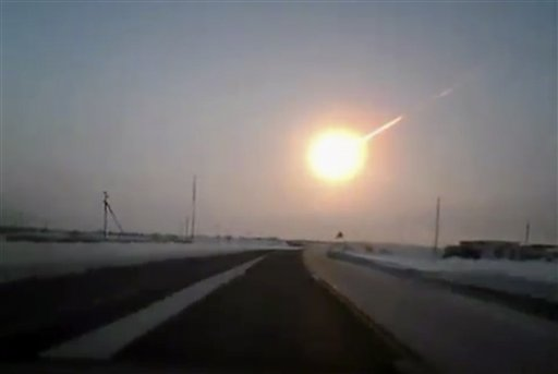 The meteor contrail is seen in this frame grab made from a video shot with a dashboard camera from a highway in Kazakhstan, Russia.
