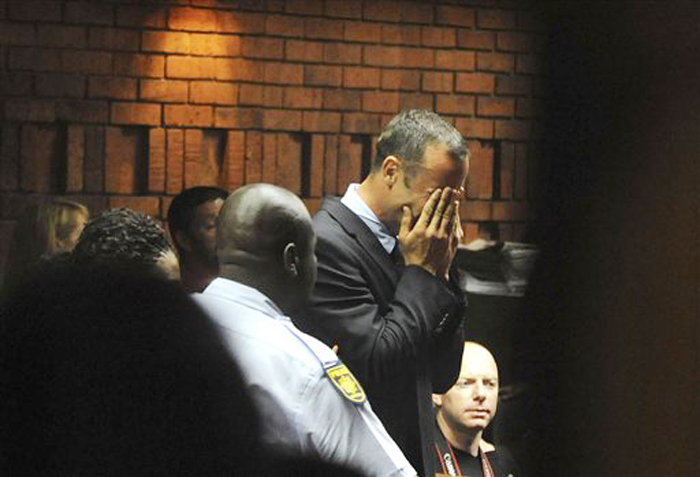 Oscar Pistorius weeps in court in Pretoria, South Africa, on Friday, Feb 15, 2013, at his bail hearing in the murder case of his girlfriend Reeva Steenkamp.