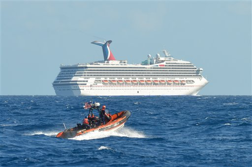 In this image released by the U.S. Coast Guard on Feb. 11, 2013, a small boat belonging to the Coast Guard Cutter Vigorous patrols near the disabled cruise ship Carnival Triumph in the Gulf of Mexico on Monday. The ship has been floating aimlessly about 150 miles off the Yucatan Peninsula since a fire erupted in the aft engine room early Sunday, knocking out the ship's propulsion system.