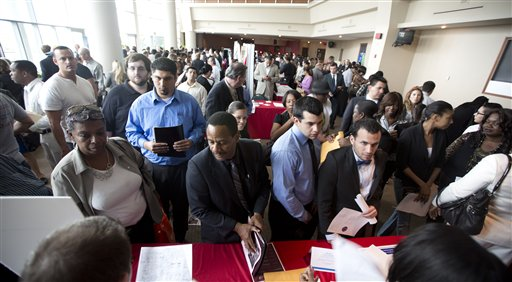 Job seekers fill a room at the job fair in Sunrise, Fla., on Tuesday. U.S. employers added 157,000 jobs in January, and hiring was much stronger at the end of 2012 than previously thought, providing reassurance that the job market held steady even as economic growth stalled, according to Labor Department reports released Friday.