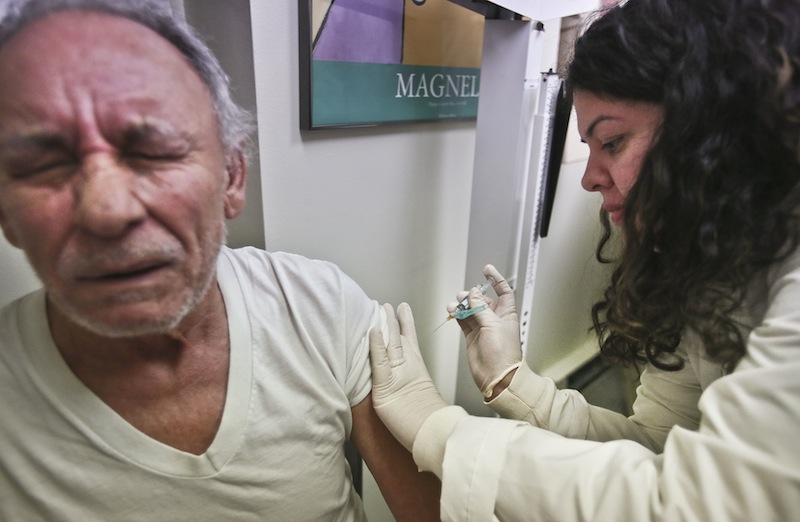 In this Tuesday, Jan. 15, 2013 file photo, Carlos Maisonet, 73, reacts as Dr. Eva Berrios-Colon, a professor at Touro College of Pharmacy, injects him with flu vaccine during a visit to the faculty practice center at Brooklyn Hospital in New York. Health officials said Thursday, Feb. 21, 2013 this season's flu shot was only 9 percent effective in protecting seniors against the most common and dangerous flu bug. Flu vaccine tends to protect younger people better than older ones and is never 100 percent effective. But experts say the preliminary results are disappointing and highlight the need for a better vaccine. (AP Photo/Bebeto Matthews, File)