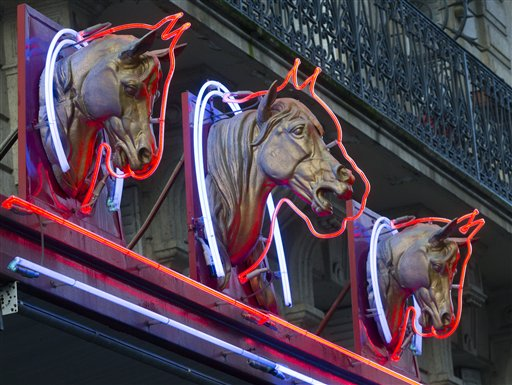 Three statues of horses' heads advertise a horsemeat butcher shop in Paris, on Friday. French Consumer Affairs Minister Benoit Hamon said Thursday that it appeared fraudulent meat sales over several months reached across 13 countries and 28 companies. He identified French meat wholesaler Spanghero as a major culprit.