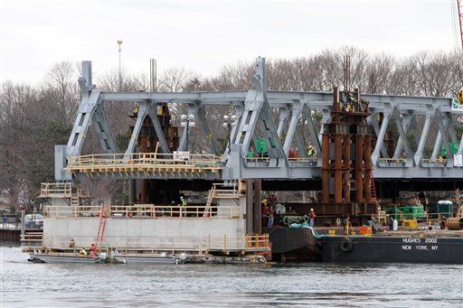 In this Jan. 15, 2013, photo, a new section of the Memorial Bridge is set into position. The new span is expected to open this summer.