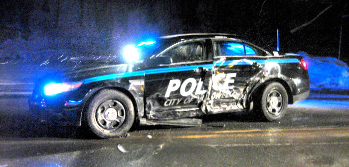 A Hallowell Police Department 2013 Ford Taurus police cruiser had its rear axle twisted and left doors crushed, likely totaling it, following a Saturday evening accident on Water Street near Cafe de Bangkok, according to Hallowell Police Sgt. Christopher Hutchings.