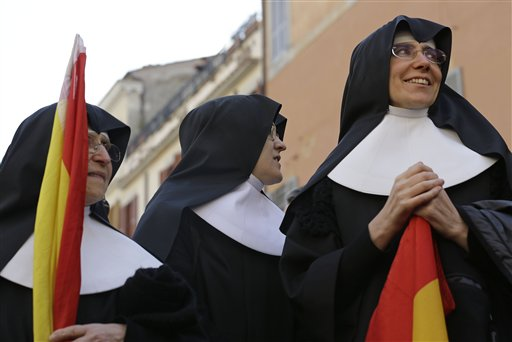 Nuns gather near the Pope's summer residence of Castel Gandolfo, the scenic town where Pope Benedict XVI will spend his first post-Vatican days.