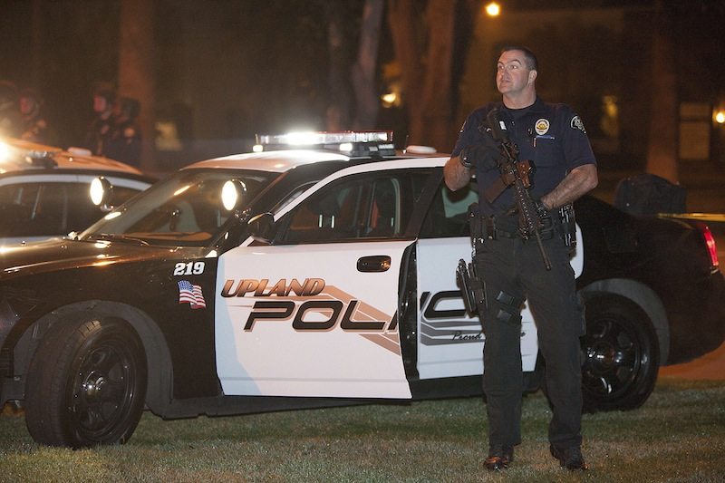 Police respond in Riverside, Calif., early Thursday morning, after one officer was killed and another critically wounded in a shoot out with a murder suspect.