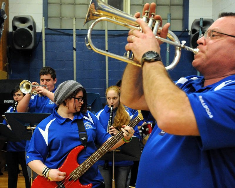 The Lawrence High School pep band performs during warmups before the Lawrence-Skowhegan boys' basketball game in Fairfield Tuesday night.