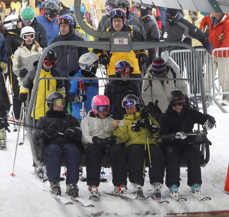 Skiers board a lift at the Sugarbush ski resort on Thursday in Warren, Vt. Last weekend's record snowfall in parts of southern New England is giving a big boost to the ski industry in northern New England.