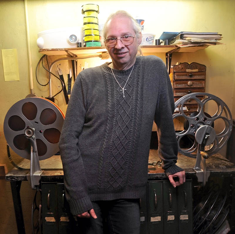Bill Lashon, the sole projectionist at the Pittsfield Community Theatre on Main Street, stands in the projection booth Thursday. Lashon's job may be in the balance with the movie industry shifting from 35 mm film to digital by the end of the year.