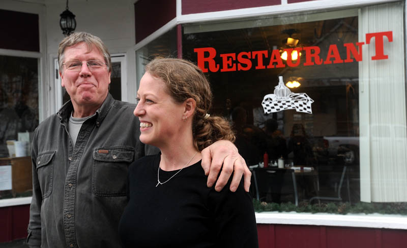 Jay Strickland and his daughter, Amber, pose for a portrait outside Thompson's Restaurant on Main Street in Bingham on Wednesday.