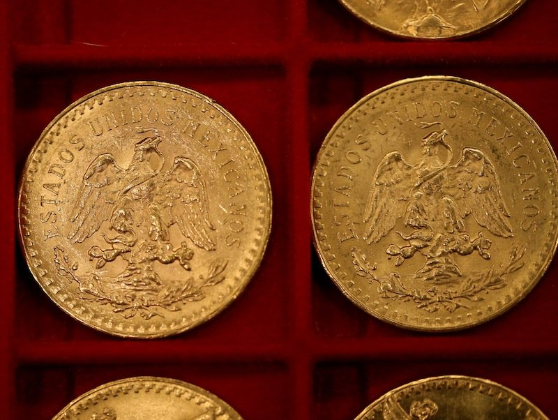 Mexican 50 peso pieces were among the $3.5 million in gold coins auctioned off in Carson City, Nev., on Tuesday, Feb. 26, 2013. Recluse Walter Samaszko died in June 2012, leaving thousands of coins hidden in his garage. (AP Photo/Las Vegas Review-Journal, Cathleen Allison)