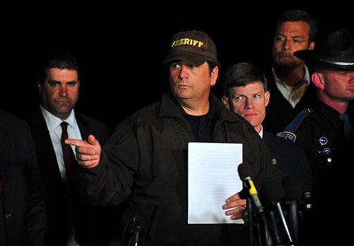 Dale County Sheriff Wally Olsen answers questions during a news conference late Monday in Midland City, Ala., where authorities stormed an underground bunker, freeing the 5-year-old boy and leaving his captor dead after a week of fruitless negotiations.