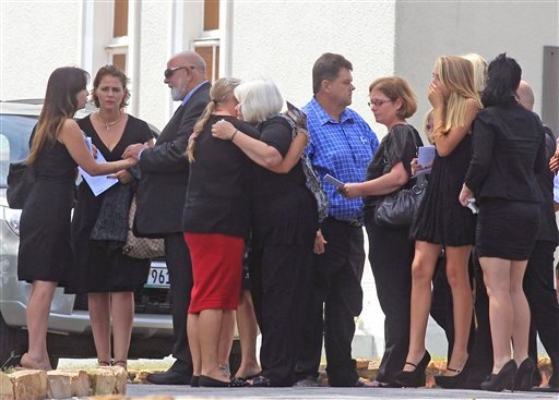 Barry Steenkamp, third left, the father of Reeva Steenkamp, greets people as he and others attend her funeral, in Port Elizabeth, South Africa, on Tuesday.