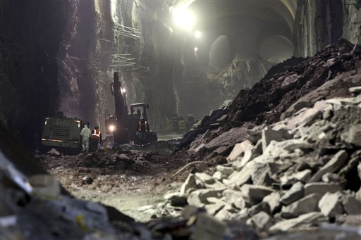 Contractors work on the East Side Access project beneath midtown Manhattan, in New York. The East Side Access is one of three bold projects under New York that will expand what's already the nation's biggest mass-transit system by 2019.