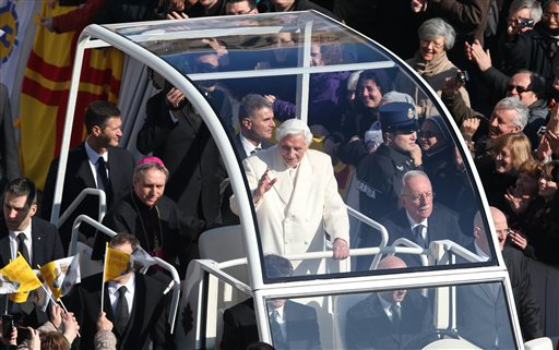 Pope Benedict XVI greets pilgrims in St. Peter's Square at the Vatican on Wednesday for the final time before retiring, waving to tens of thousands of people who have gathered to bid him farewell. At one point he stopped to kiss a baby handed up to him by his secretary.