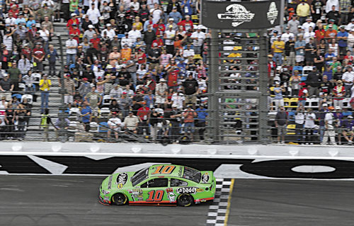NICE RUN: Danica Patrick crosses the start/finish line to take the lead shortly before the halfway point of the Daytona 500 on Sunday at Daytona International Speedway in Daytona Beach, Fla. Patrick finished eighth.