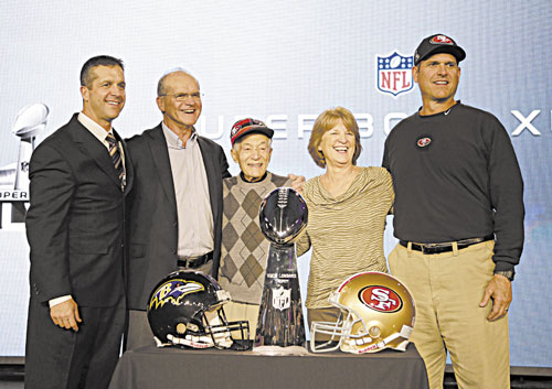 FAMILY TIME: San Francisco 49ers head coach Jim Harbaugh, right, and Baltimore Ravens head coach John Harbaugh, left, pose with their parents, Jack and Jackie, and grandfather Joe Cipiti during a news conference Friday in New Orleans.