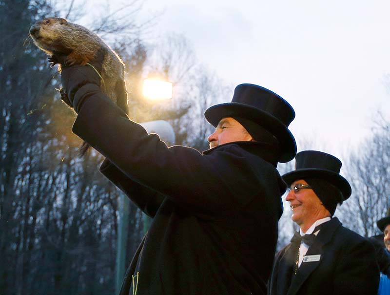 Groundhog Club Co-handler John Griffiths holds Punxsutawney Phil on Saturday. The club said Phil did not see his shadow and there will be an early spring.