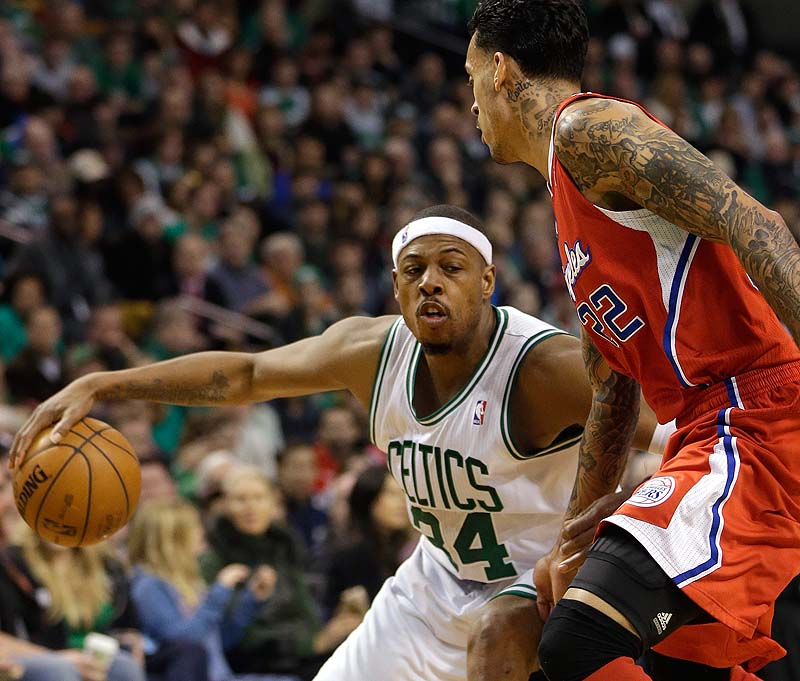 Paul Pierce of the Celtics looks for an opening around Los Angeles Clippers forward Matt Barnes in the fourth quarter Sunday at TD Garden. The Celtics defeated the Clippers, 106-104.