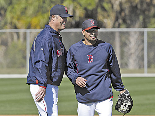 GOOD TO HAVE YOU HERE: Boston Red Sox outfielder Shane Victorino, right, laughs with manager John Farrell during a spring training workout Sunday in Fort Myers, Fla.