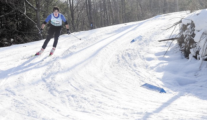 Nolan Poulin, of Manchester, rounds the corner coming down a hill during the Bond Brook Inaugural Race in Augusta.