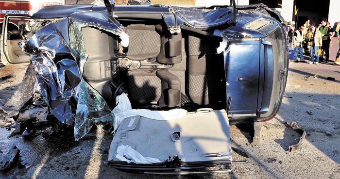 Nancy Hazard's car lies demolished and overturned on March 18, after it plowed into five vehicles parked at a traffic light in Waterville, sending six peole to the hospital.