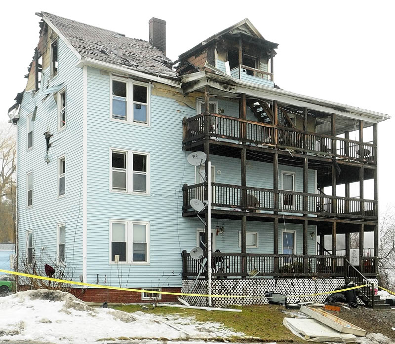 This photo show the damage to 1 Penobscot St. on Jan. 30, 2013, the day after it was heavily damaged by a fire. The Fire Marshal's Office seeks a witness who left the scene five to 10 minutes before the fire was reported, saying he is not a suspect but may have information that could help solve the origin of the fire.