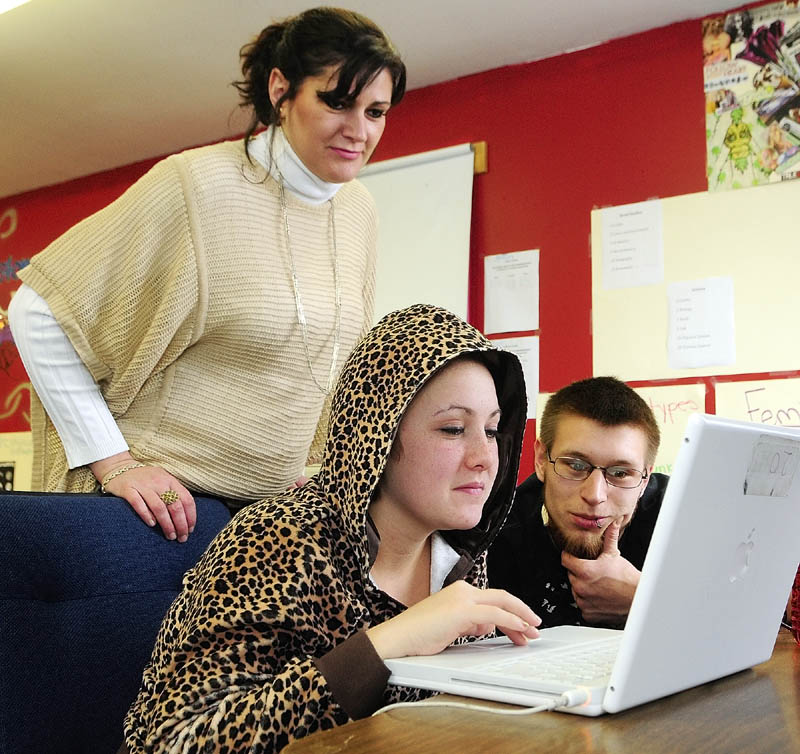 Teacher Evelyne Walther, left, works with students Rachel Gilbert, of Winthrop, center, and Ben Langley, of South Monmouth, on Wednesday in the Carleton Project building in Winthrop.