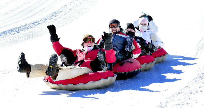 The Eaton Mountain Tubing and Skiing facility in Skowhegan was filled with people who spent the day sliding and having fun on Monday. This group came from North Country Harley Davidson shop in Augusta and are, from left, Mitch Van Horn, Derek Blondin, Scott Paul, Lauren Stetson and Aryn Weymouth.