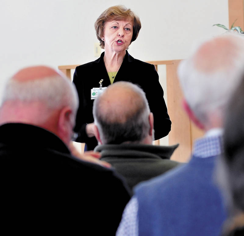 President and CEO of Franklin Memorial Hospital/Franklin Community Health Network, Rebecca Ryder, explains to area community and organization leaders the financial status of the institutions and how to reduce expenses on Wednesday in Farmington.