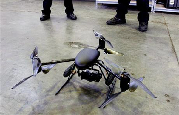 This April 27, 2012, photo shows the Draganflyer X6 helicopter in Seattle. A proposal by state Sen. John Patrick, D-Rumford, would limit the ability of Maine law enforcement to use drones and require a warrant in most cases.