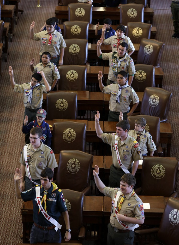 Boy Scouts recite their oath Saturday at the Texas capitol in Austin. The Boy Scouts organization emphatically reaffirmed its no-gays policy seven months ago, but said last week it was considering changing the stance.