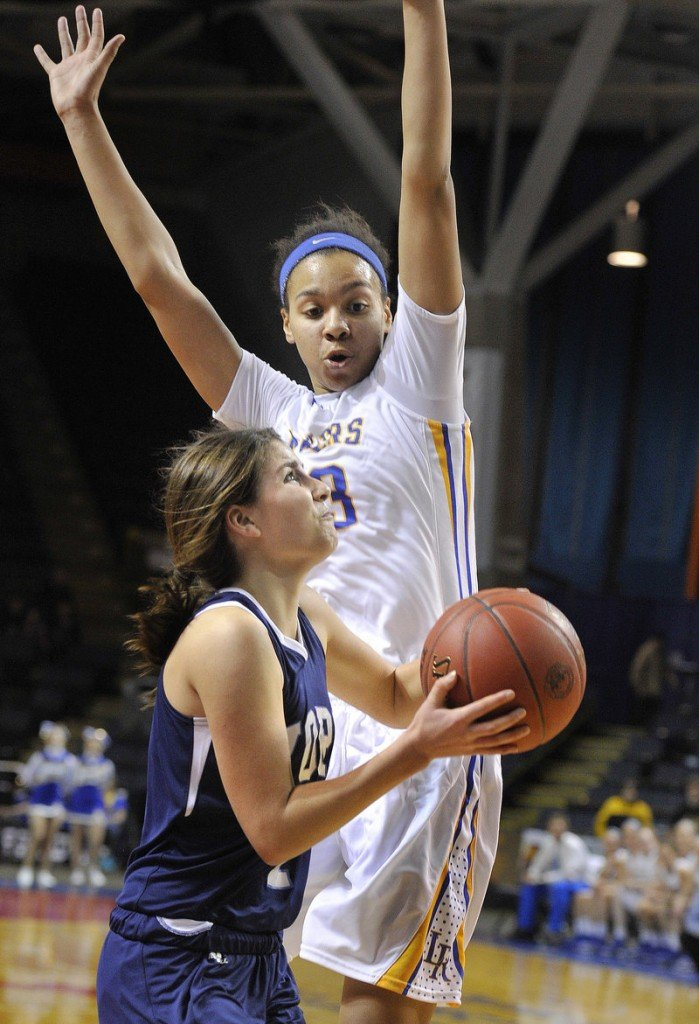 Tiana-Jo Carter loomed large on offense and defense for Lake Region -- here cutting off a drive by Ruby Cribby of York -- and was named Western Class B's top player/sportsman.