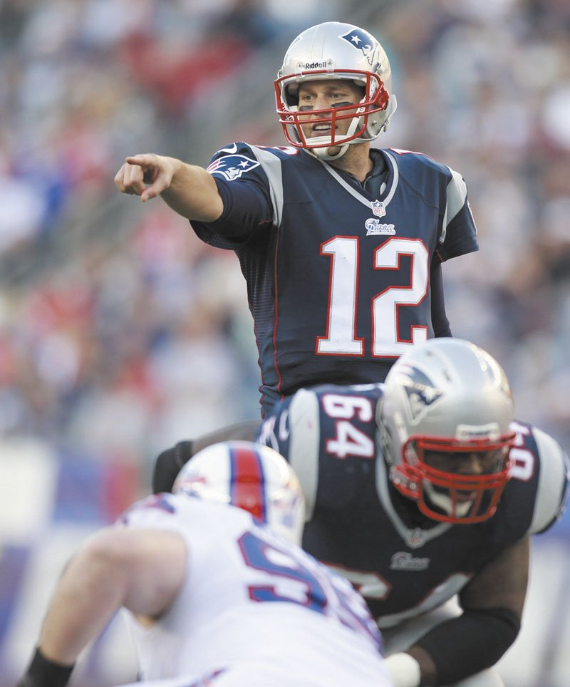 A WIN-WIN DEAL: Tom Brady (12) didn't exactly take a pay cut with the extension he agreed to with the New England Patriots, but the deal give his team flexibility under the salary cap to sign some much-needed pieces. Gillette Stadium