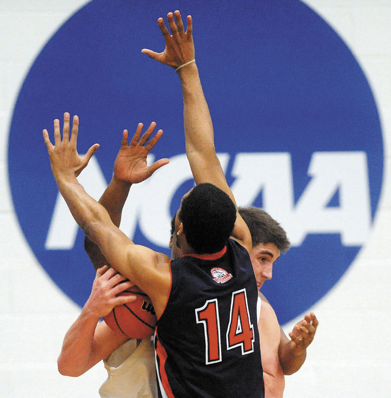 University of Maine at Farmington's Ben Johnson is double-teamed by New England College defenders Joel DeMadet, 14, and Jaskin Melendez in the first half Tuesday of a North Atlantic Conference tournament game in Farmington. The Beavers won 85-66. For the local college roundups, see C4.