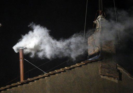 White smoke emerges from the chimney on the roof of the Sistine Chapel at the Vatican on Wednesday.