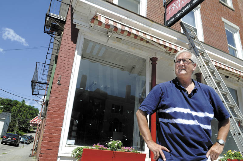 Thomas Hibbert stands outside the former Boynton's Market in Hallowell in June 2011. Hibbert, whose plans to reopen the market under a new name fell apart after the Kennebec Journal reported he pleaded guilty in January 2010 to felony theft for allegedly stealing $74,000 of his mother's money and that he had filed for bankruptcy protection in 2005, now faces a disclosure hearing on how he'll pay a $150,000 civil settlement in a 2011 case.