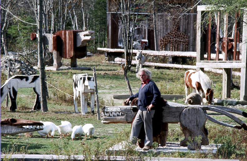 The late Maine artist Bernard Langlais at his Cushing estate, surrounded by some of his sculptures.