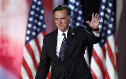 In this Nov. 7, 2012, photo, Republican presidential candidate Mitt Romney waves to supporters at an election night rally in Boston.