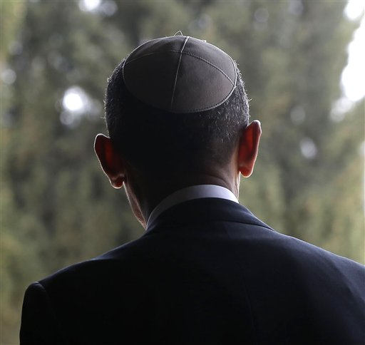 U.S. President Barack Obama walks out of the Hall of Remembrance at the Yad Vashem Holocaust Memorial in Jerusalem, Israel, Friday, March 22, 2013. (AP Photo/Pablo Martinez Monsivais)