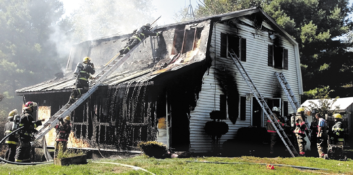 Firefighters from several departments extinguish fire that destroyed the Turner home on the Libby Hill Road in Palmyra in 2007.