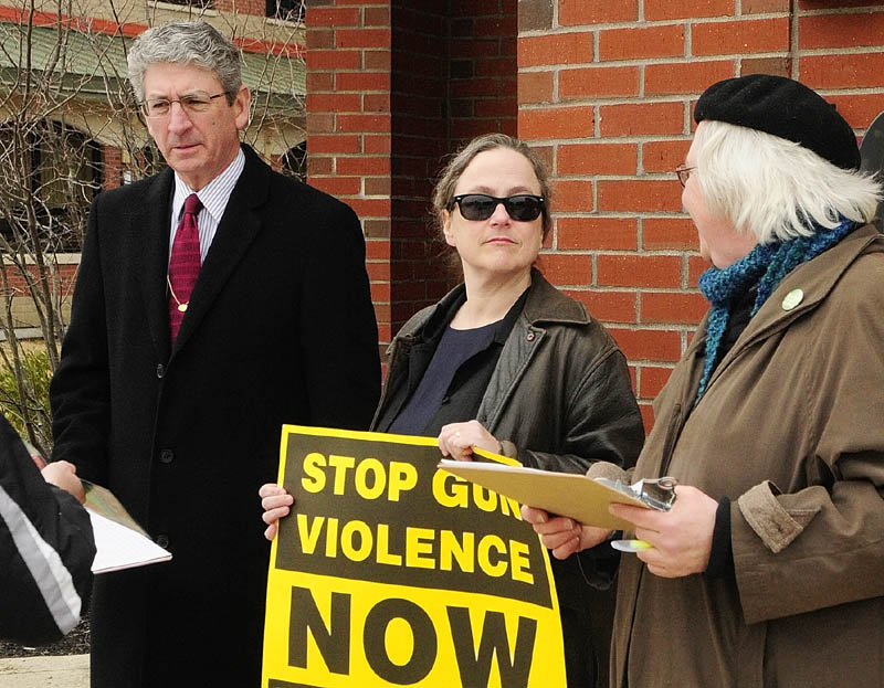 Augusta Mayor William Stokes, left, Deb Fahy, of Hallowell, and Leslie Manning, of the Maine Council of Churches, stand outside the Randall Student Center on Thursday at the University of Maine at Augusta.