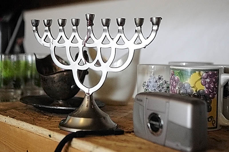 A menorah, metal gravy boat and digital camera are among the items for sale at Bottles and More Redemption Shop in North Monmouth.