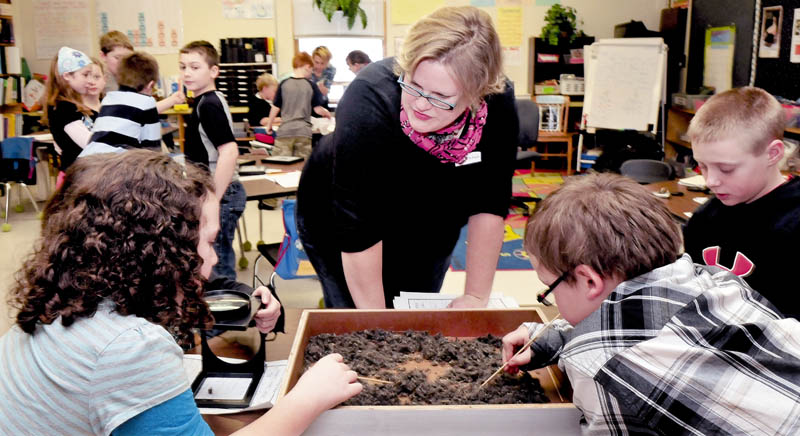 Kids at the Bloomfield Academy in Skowhegan learn about birds as L.C. Bates Museum Educator Serena Sanborn talks about the contents of owl pellets the kids picked through on Thursday. The pellets, regurgitated food that can not be digested, was sanitized for the class.