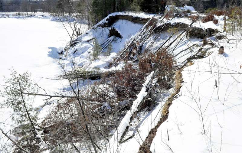 Snow and frozen ground on Thursday have stabilized the eroded bank between the Sandy River and Whittier Road in Farmington, but officials are concerned about the effects warm temperatures and spring rain will have on the riverbank.
