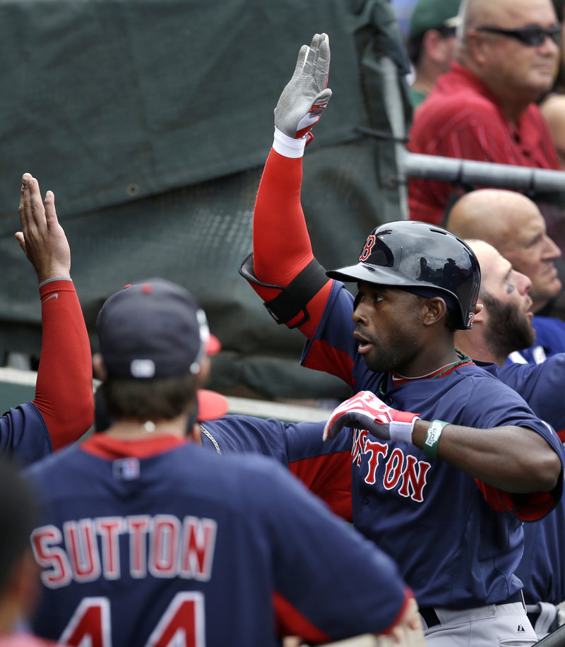 Jackie Bradley Jr. is congratulated by his teammates after hitting a three-run homer in the second inning of Boston's exhibition game Sunday against the Philadelphia Phillies at Clearwater, Fla. Bradley finished with four RBI, and the Red Sox won, 7-6.